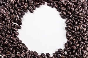 Brown dark coffee beans isolated on