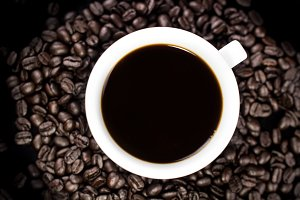 Black coffee in white cup with coffe