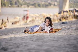 one young girl, relaxing reading a b