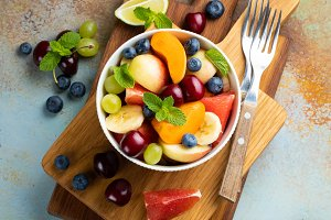 Bowl of healthy fresh fruit salad on