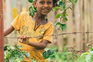 Ethiopian girl behind a fence