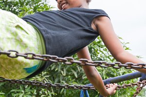 Ethiopian girl swinging on a swing
