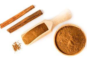 Cinnamon sticks, ground in a wooden