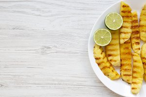 Grilled pineapple wedges with lime
