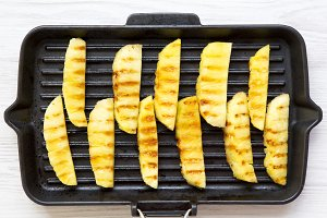 Grilled pineapple wedges in grilling