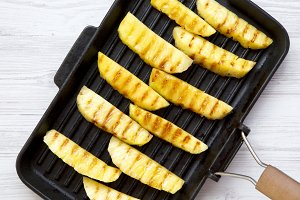 Grilled pineapple slices in grilling