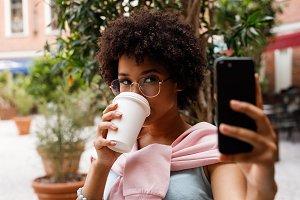Female blogger taking selfie