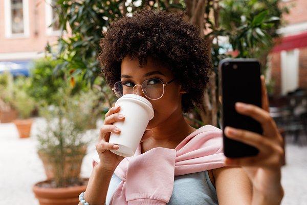 People Stock Photos: Artem Varnitsin - Female blogger taking selfie