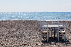 Table with chairs on the beach