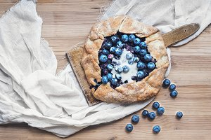 Rustic blueberry pie with cream