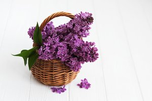 Basket with lilac flowers