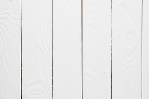Textured empty white wooden backgrou