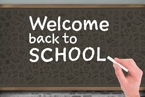 Hand writing with chalk Welcome back