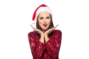 surprised woman in santa hat