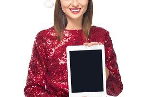 girl in santa hat with digital table