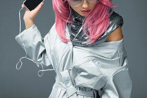 stylish girl with earphones and smar