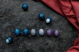 Painted chicken eggs on dark backgro