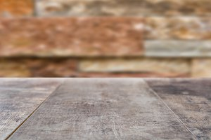 Wooden board empty and brick wall