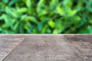 Wooden board empty with blurred gras