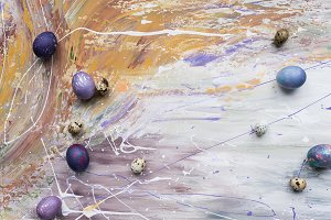 Colored Easter eggs on stained backg