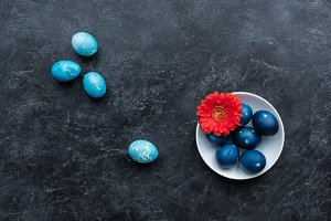 Colored Easter eggs in plate and on