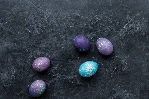 Colorful Easter eggs on dark backgro
