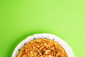 potato omelet on colorful background