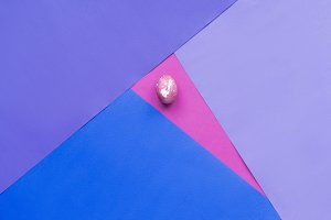 Painted egg on background in purple