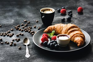 Croissant, berries, jam and coffee