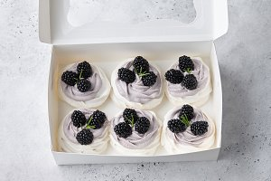 Set of Pavlova cakes with blackberry