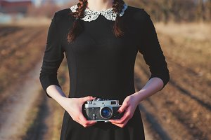 Cute young girl with vintage camera