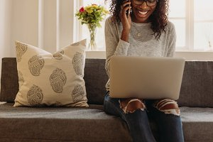 Woman managing business from home