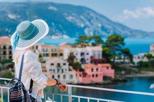 Tourist woman wearing blue sunhat