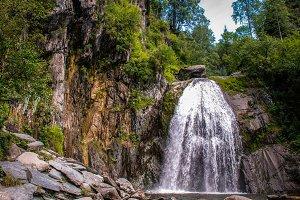 Alpine waterfall in mountain