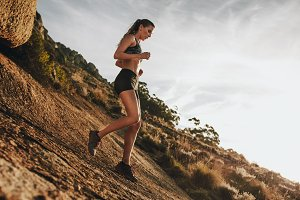 Woman trail runner training for down