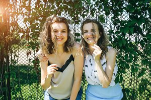 Funny happy emotions of sisters