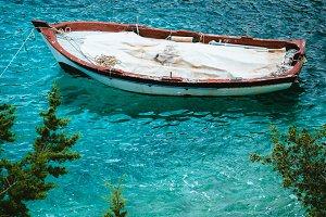 White wooden fishing boat in bay