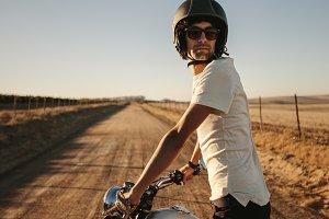 Male bike on countryside road