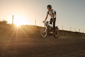 Man riding off-road on vintage bike