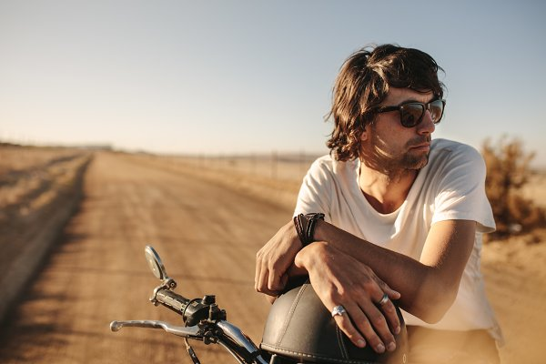 People Stock Photos: Jacob Lund Photography - Man with bike standing on rural road