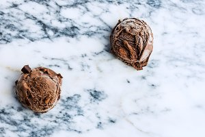 Chocolate ice cream scoops on marble