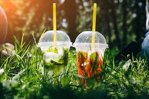 Summer cocktails in green grass