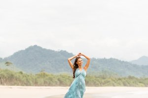 Pretty girl in blue dress on the bea