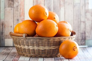 Basket with juicy oranges. Fruits, o