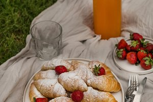 Picnic with croissant and orange