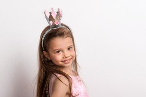 Portrait of a small girl with crown