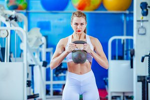 Fitness woman training by kettlebell