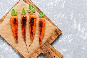 Baked carrots with green tails on a