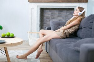 Woman relaxing in sofa at home