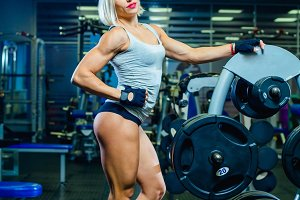 Muscular sexy fitness woman woman
